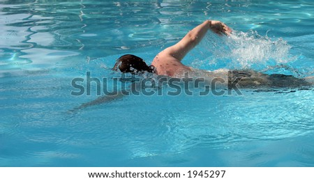 Man swimming in a pool