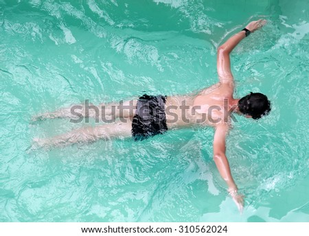 Man swimming in the swimming pool
