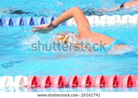 Man swimming laps in a community competition swimming pool - stock photo