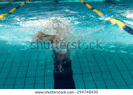 man swimming the front crawl in a pool - stock photo