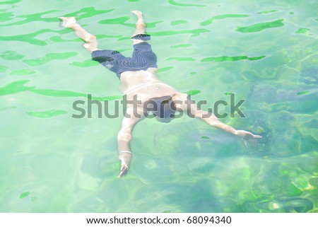 Man swimming underwater - stock photo