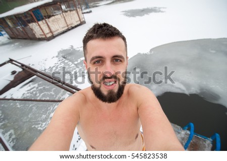 man take his journey selfie photo with wide angle camera, ice hole swimming
