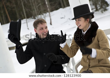 Man take off hat when woman making point