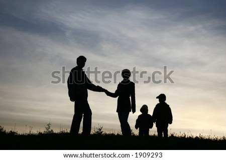 man take woman with two children. silhouette