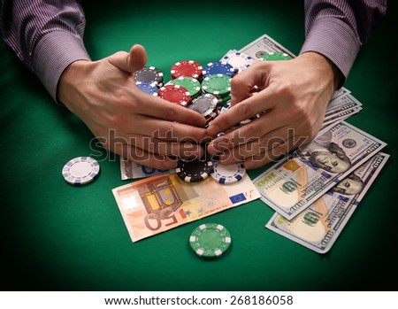 man takes Casino Jackpot, close up - stock photo