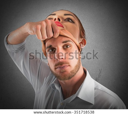 Man takes off the mask of woman - stock photo