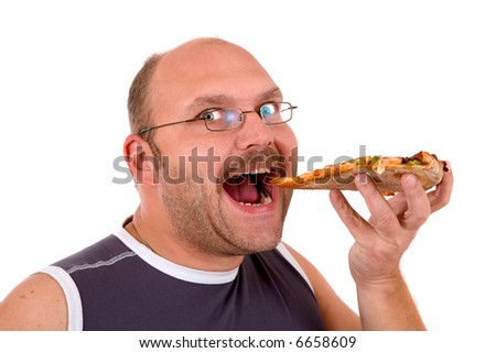 man taking a bit bite out of his slice of pizza