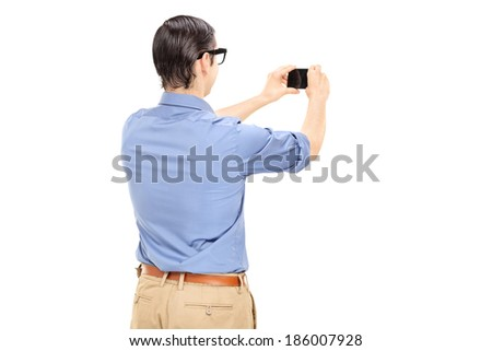 Man taking a picture with cell phone isolated on white background - stock photo