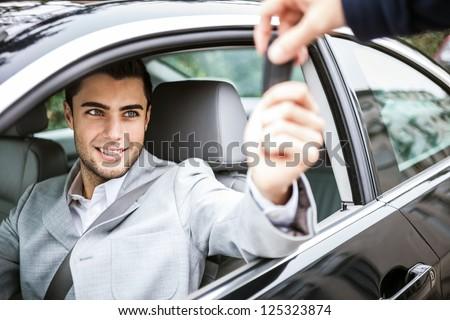 Man taking car key - stock photo
