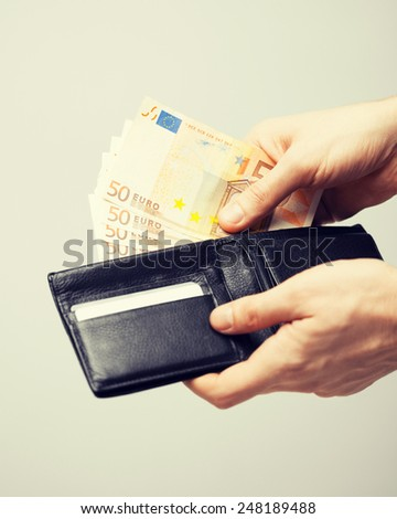 man taking euro cash money out of the wallet - stock photo