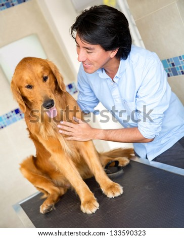 Man taking his dog to the vet