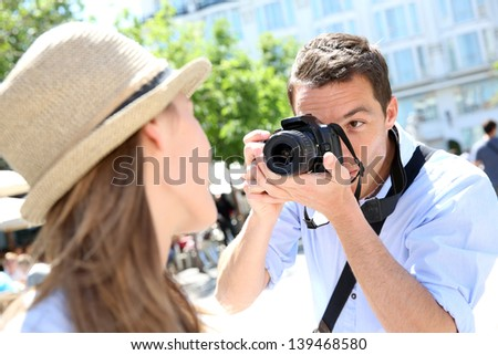 Man taking picture of girlfriend during week-end - stock photo