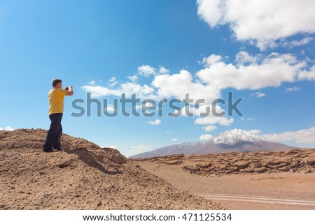 Man taking pictures of Bolivian altiplano