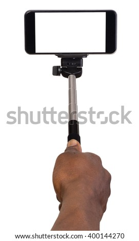 Man taking selfie using hand hold monopod and a mobile phone - stock photo