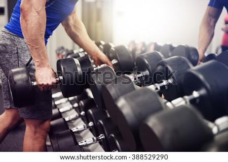 Man taking the heaviest weight - stock photo