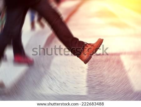 Man taking the step (onto zebra crossing) - stock photo