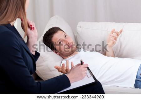 Man talking about problems with therapist, horizontal - stock photo