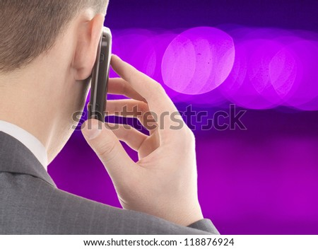man talking on a mobile phone on bokeh background - stock photo