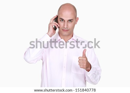 Man talking on the phone and giving the thumb's up - stock photo
