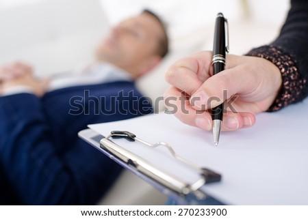 Man talking to his therapist - stock photo