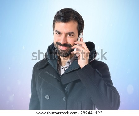 Man talking to mobile over shiny background
