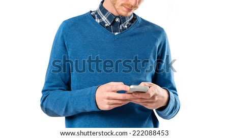 Man talking to mobile over white background