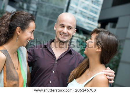 Man talking with two girls - stock photo