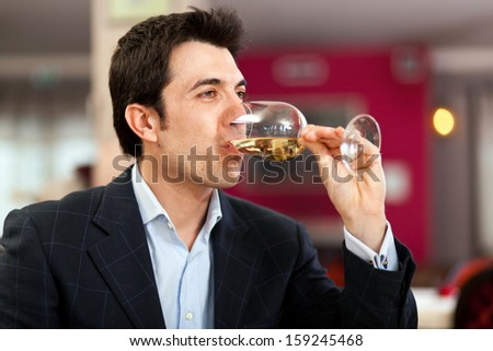 Man tasting a white wine - stock photo