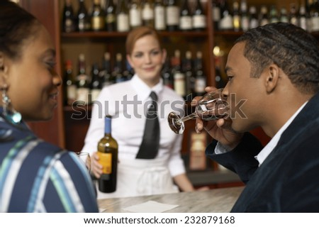 Man Tasting Wine - stock photo