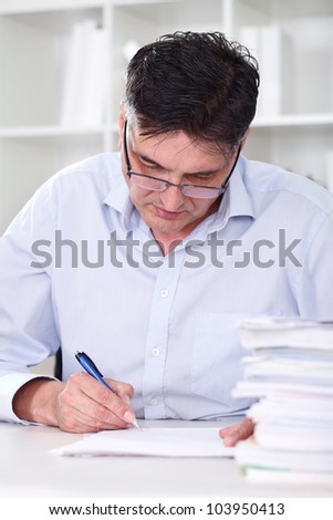 man teacher professor reading concentrated and examine tests