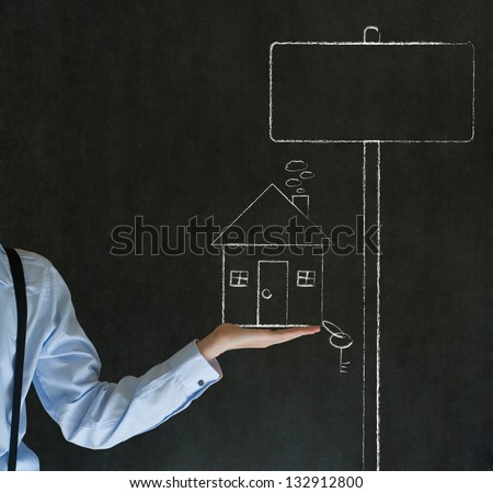 Man teacher, salesman, student or businessman holding chalk house, home or real estate with sales sign and key