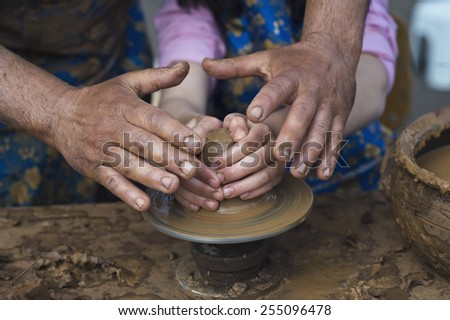 Man teaches a child of pottery - stock photo