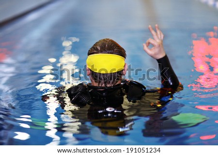 man teaches diving in the pool, swim coach - stock photo