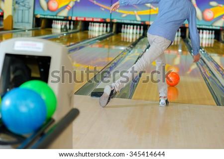 Man ten pin bowling - stock photo