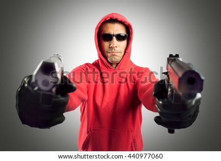 man terrorist shooting with gray background - stock photo