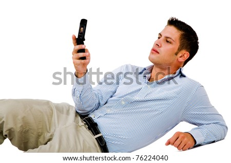 Man text messaging on a mobile phone isolated over white - stock photo