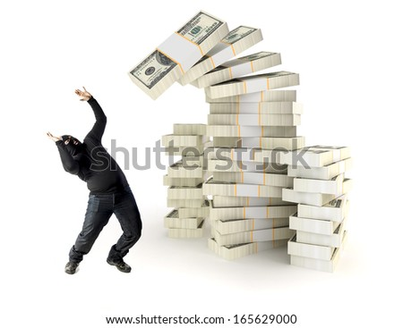 Man thief getting overwhelmed by money - stock photo
