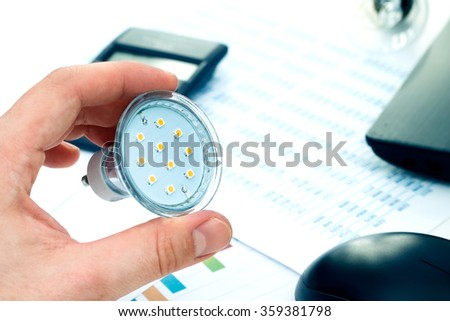 Man thinking about saving money. New solutions in energy saving - stock photo