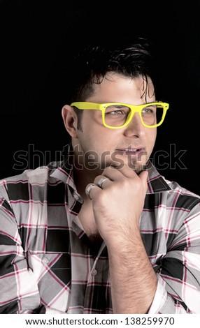 Man thinking on black background - stock photo