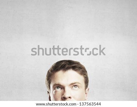 man thinking on gray background - stock photo