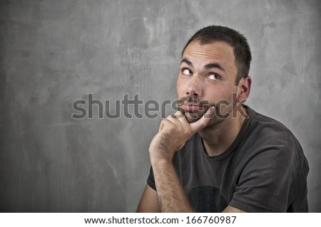 Man thinking on grey background
