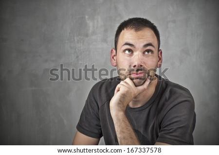 Man thinking on grey background  - stock photo