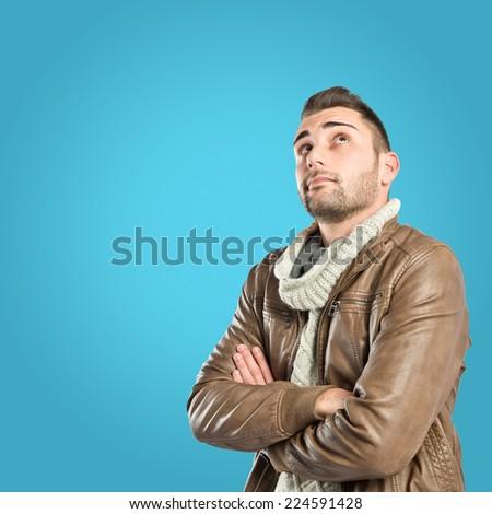 Man thinking over blue background - stock photo