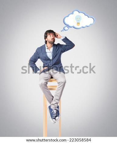 Man thinking over grey background - stock photo