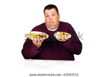 man thinking what to eat between a cheeseburger meal or a salad (isolated on white)