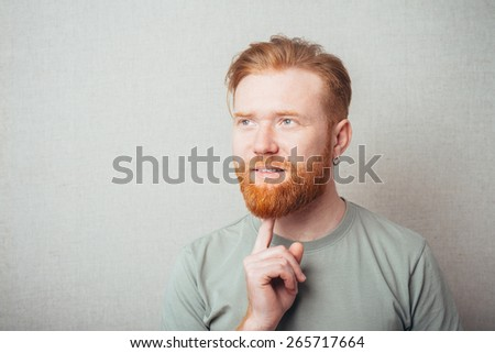 Man thinks finger beard - stock photo