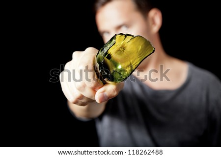 Man threatening with broken beer bottle as weapon - stock photo