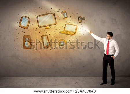 Man throwing hand drawn electronical devices concept - stock photo