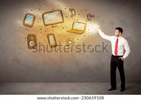 Man throwing hand drawn technologyl devices concept - stock photo