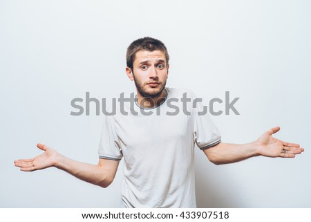 man throws up his hands - stock photo